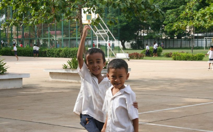 Portrait of two little boys at the sports ground, angkor-siem reap. Photographer : Mr. Axel Halbhuber